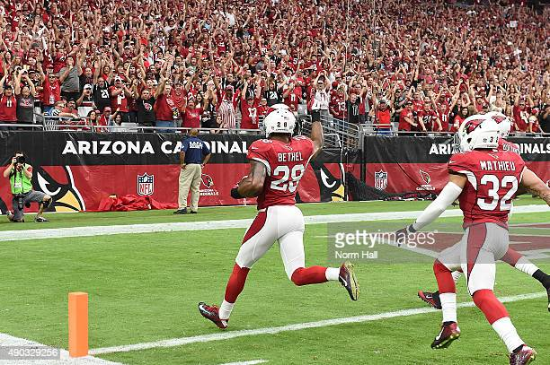 Cornerback Justin Bethel of the Arizona Cardinals intercepts the football for a touchdown in the first quarter during the NFL game against the San...