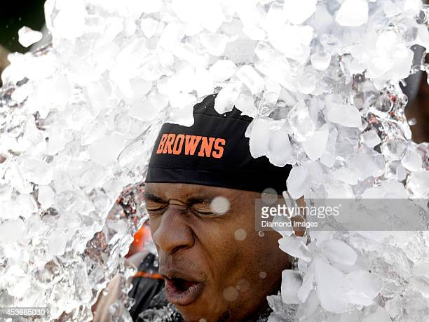 Cornerback Justin Gilbert of the Cleveland Browns tenses up as ice is dumped on him as part of the 'Ice bucket Challenge' to help raise awareness for...