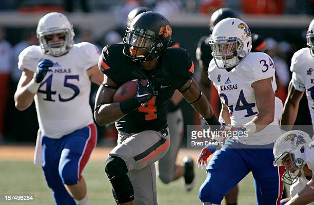 Cornerback Justin Gilbert of the Oklahoma State Cowboys runs downfield for a touchdown on the opening kickoff against the Kansas Jayhawks Novemeber...
