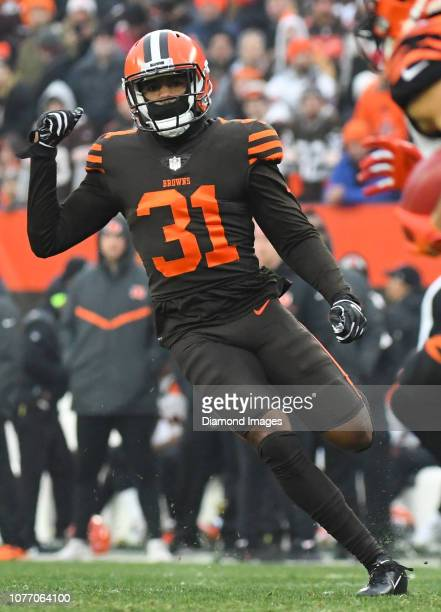 Cornerback Juston Burris of the Cleveland Browns runs downfield on a kickoff in the third quarter of a game against the Cincinnati Bengals on...