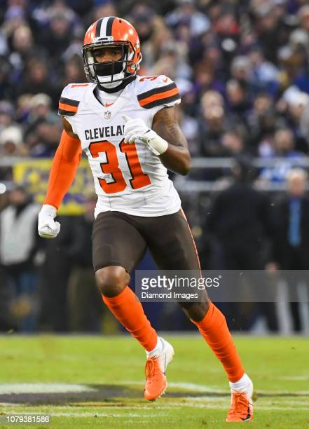 Cornerback Juston Burris of the Cleveland Browns runs downfield on a kickoff in the first quarter of a game against the Baltimore Ravens on December...