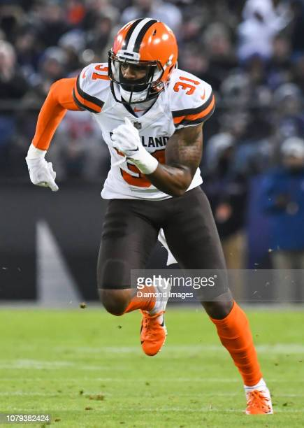 Cornerback Juston Burris of the Cleveland Browns runs downfield on a punt in the second quarter of a game against the Baltimore Ravens on December 30...