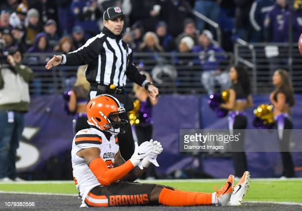 Cornerback Juston Burris of the Cleveland Browns sits in the end zone after a touchback was called on a punt in the second quarter of a game against...