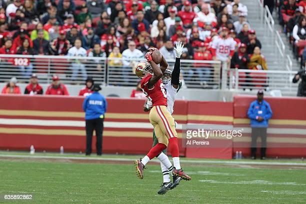 Cornerback Juston Burris of the New York Jets breaks up a pass to Wide Receiver Torrey Smith of the San Francisco 49ers at Levi's Stadium on December...