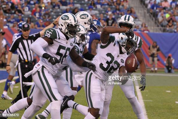 Cornerback Juston Burris of the New York Jets has an interception against the New York Giants during a preseason game on August 26 2017 at MetLife...