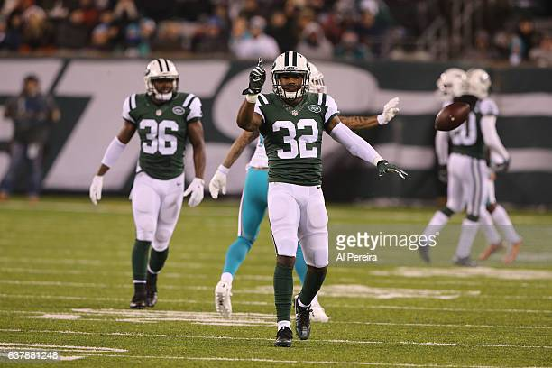 Cornerback Juston Burris of the New York Jets has his first career Interception against the Miami Dolphins at MetLife Stadium on December 17 2016 in...