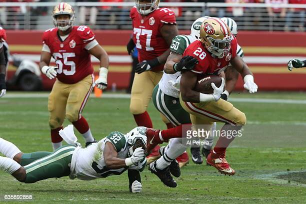 Cornerback Juston Burris of the New York Jets makes a stop against the San Francisco 49ers at Levi's Stadium on December 11 2016 in Santa Clara...