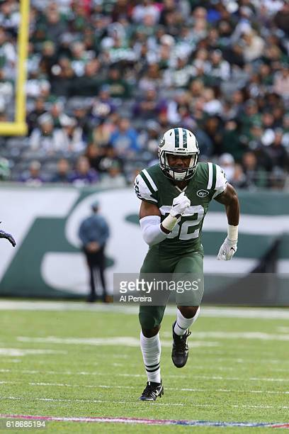 Cornerback Juston Burris of the New York Jets runs downfieldagainst the Baltimore Ravens during their game at MetLife Stadium on October 23 2016 in...