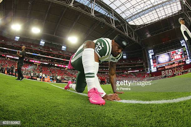 Cornerback Juston Burris of the New York Jets stretches before the game against the Arizona Cardinals at University of Phoenix Stadium on October 17...