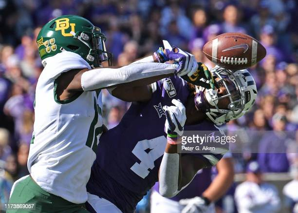 Cornerback Kalon Barnes of the Baylor Bears brakes up a pass intended for wide receiver Malik Knowles of the Kansas State Wildcats during the first...