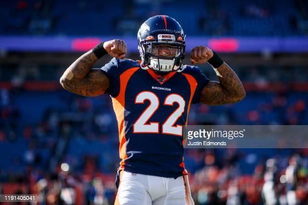 Cornerback Kareem Jackson of the Denver Broncos flexes his muscles before a game against the Los Angeles Chargers at Empower Field at Mile High on...
