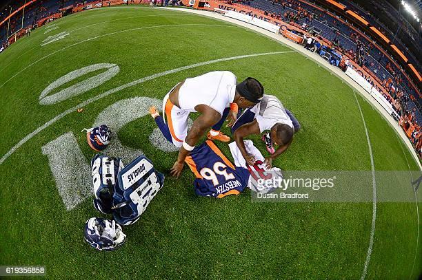 Cornerback Kayvon Webster of the Denver Broncos and defensive back Charles James of the Houston Texans exchange jerseys after a game at Sports...