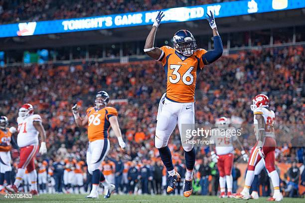 Cornerback Kayvon Webster of the Denver Broncos gestures to the crowd during the game against the Kansas City Chiefs at Sports Authority Stadium on...