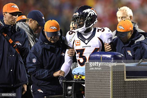 Cornerback Kayvon Webster of the Denver Broncos is helped from the field during the first half at the Kansas City Chiefs at Arrowhead Stadium...