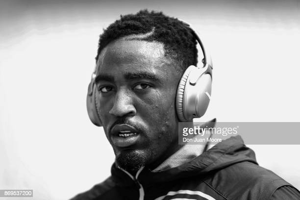 Cornerback Kayvon Webster of the Los Angeles Rams with a pair of BOSE headphones on as he warmsup before the game against the Jacksonville Jaguars at...