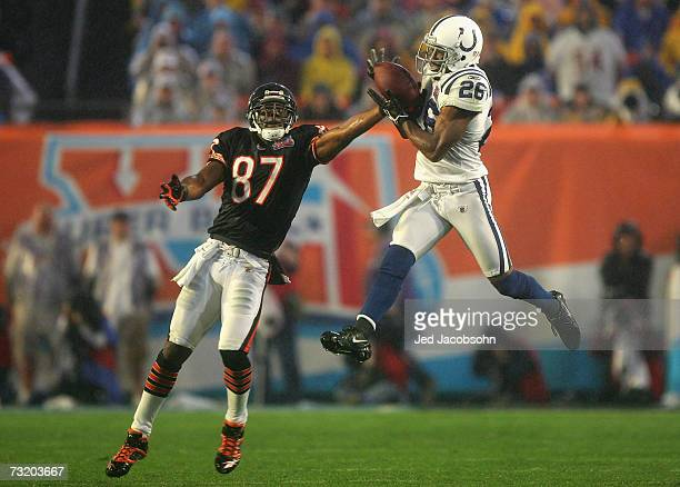 Cornerback Kelvin Hayden of the Indianapolis Colts catches an interception over Muhsin Muhammad of the Chicago Bears before returning for a 56yard...