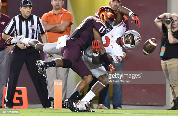 Cornerback Kendall Fuller of the Virginia Tech Hokies interferes with wide receiver Michael Thomas of the Ohio State Buckeyes in the second half at...