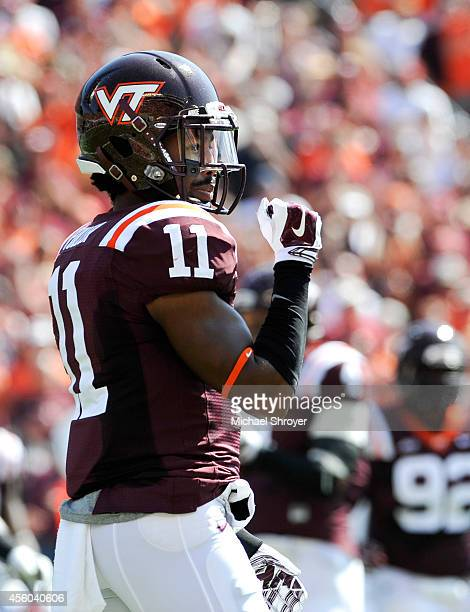 Cornerback Kendall Fuller of the Virginia Tech Hokies reacts after a defensive play against the Georgia Tech Yellow Jackets in the first half at Lane...