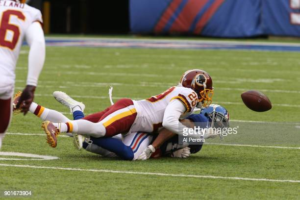 Cornerback Kendall Fuller of the Washington Redskins breaks up a pass against the New York Giants at MetLife Stadium on December 31 2017 in East...