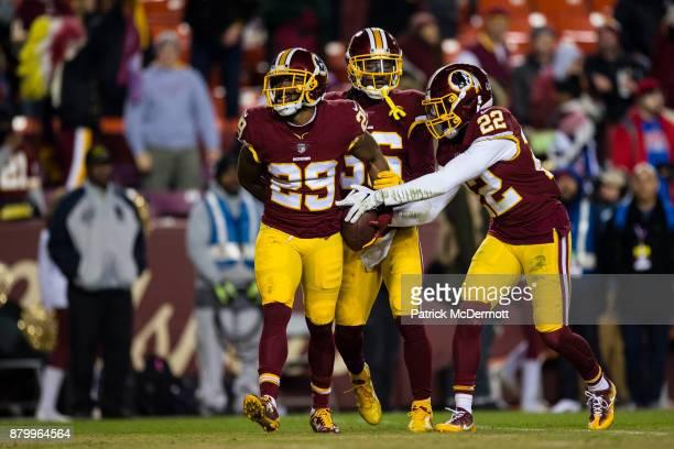 Cornerback Kendall Fuller of the Washington Redskins celebrates wtih free safety DJ Swearinger and strong safety Deshazor Everett after intercepting...