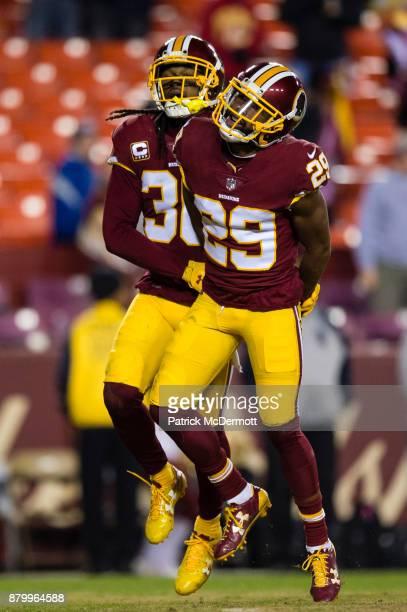 Cornerback Kendall Fuller of the Washington Redskins celebrates wtih free safety DJ Swearinger after intercepting a pass thrown by quarterback Eli...