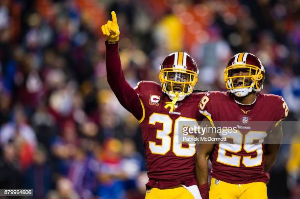 Cornerback Kendall Fuller of the Washington Redskins celebrates wtih free safety DJ Swearinger after intercepting a pass thrown by quarterback Eli...
