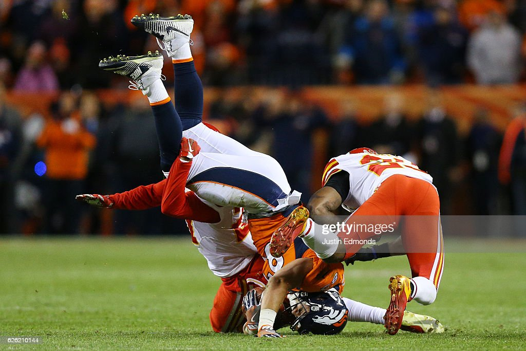 Cornerback Kenneth Acker #27 of the Kansas City Chiefs and Eric Berry #29 tackle tight end A.J. Derby #83 of the Denver Broncos for a first down in overtime at Sports Authority Field at Mile High on November 27, 2016 in Denver, Colorado.