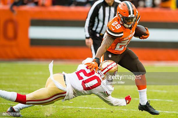 Cornerback Kenneth Acker of the San Francisco 49ers ties to tackle running back Duke Johnson of the Cleveland Browns during the second half at...