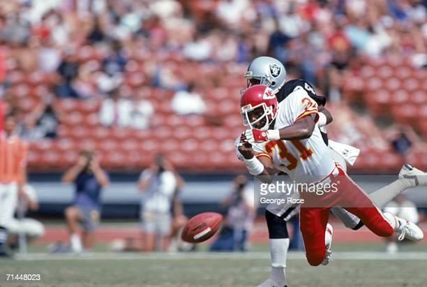 Cornerback Kevin Ross of the Kansas City Chiefs blocks a pass intended for wide receiver Jessie Hester of the Los Angeles Raiders during a game at...