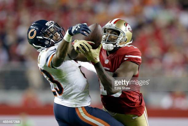 Cornerback Kyle Fuller of the Chicago Bears intercepts a pass intended for wide receiver Michael Crabtree of the San Francisco 49ers at Levi's...