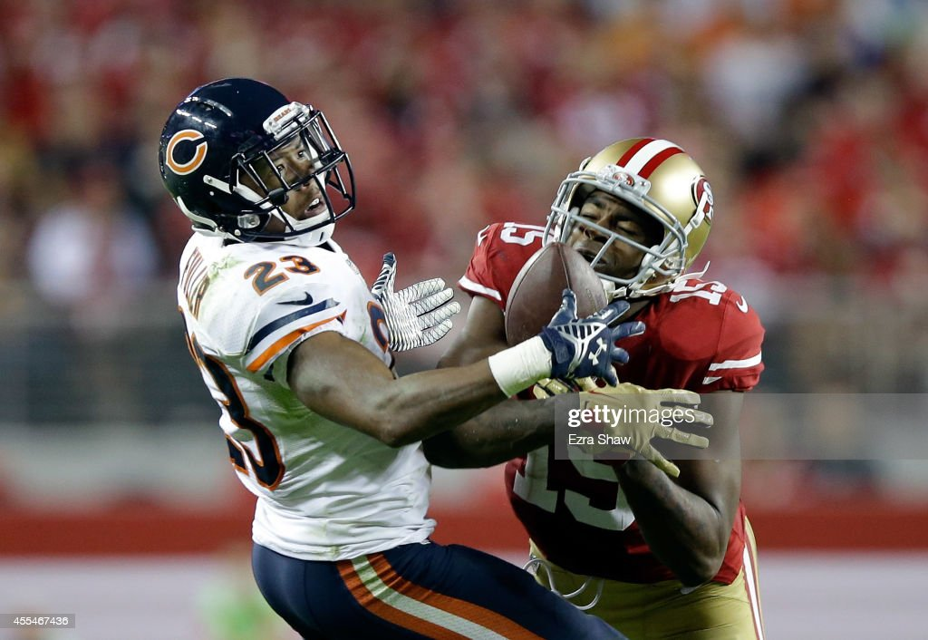 Cornerback Kyle Fuller #23 of the Chicago Bears intercepts a pass intended for wide receiver Michael Crabtree #15 of the San Francisco 49ers at Levi's Stadium on September 14, 2014 in Santa Clara, California.