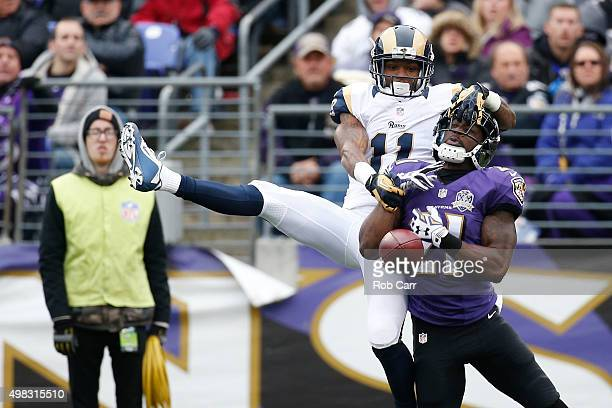 Cornerback Lardarius Webb of the Baltimore Ravens breaks up a pass intended for wide receiver Tavon Austin of the St Louis Rams in the second quarter...