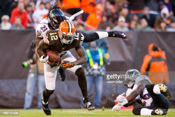 Cornerback Lardarius Webb of the Baltimore Ravens tackles wide receiver Josh Gordon of the Cleveland Browns who makes the reception for a first down...