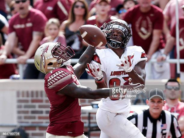 Cornerback Levonta Taylor of the Florida State Seminoles breaksup a touchdown catch intended for Wide Receiver Dez Fitzpatrick of the Louisville...
