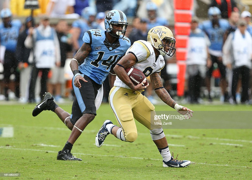 Cornerback Louis Young #8 of the Georgia Tech Yellow Jackets returns an interception while wide receiver Quinshad Davis #14 of the North Carolina Tar Heels pursues him during the game at Bobby Dodd Stadium at Historic Grant Field on September 21, 2013 in Atlanta, Georgia.