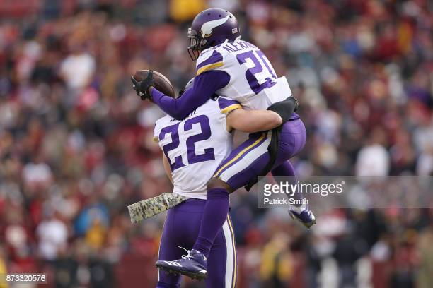 Cornerback Mackensie Alexander of the Minnesota Vikings celebrates with free safety Harrison Smith of the Minnesota Vikings after an interception...