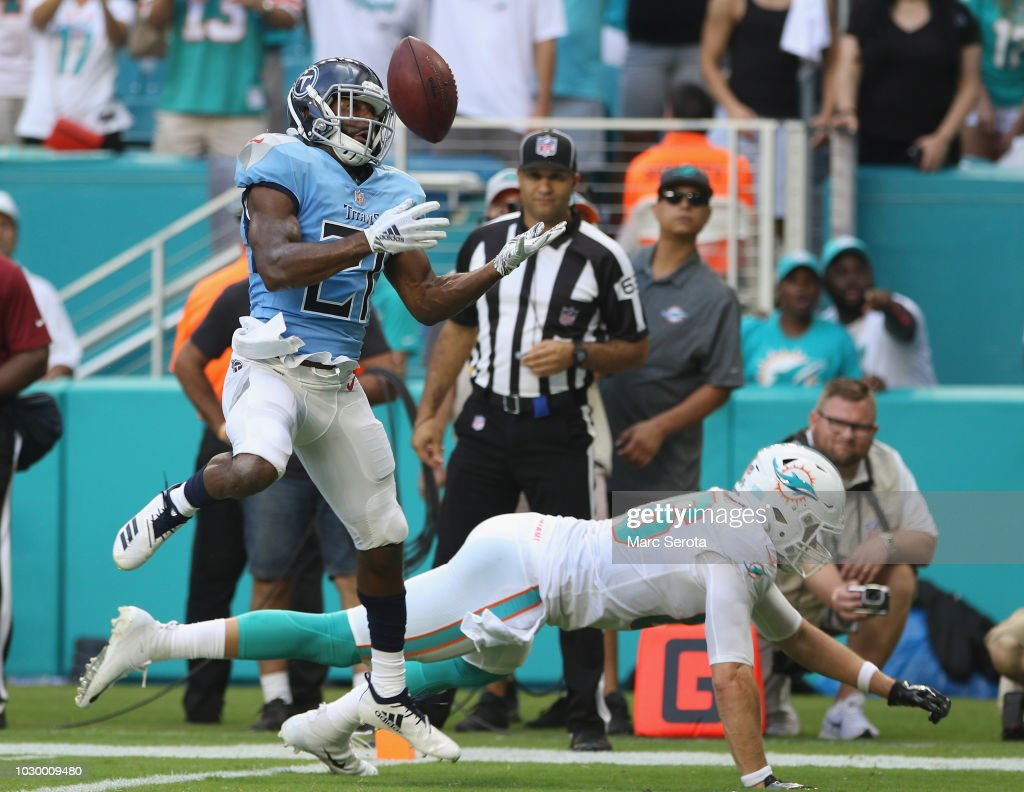 Cornerback Malcolm Butler #21 of the Tennessee Titans intercepts a pass in front of Tight End Mike Gesikii #86 of the Miami Dolphins during the third quarter at Hard Rock Stadium on September 9, 2018 in Miami, Florida.