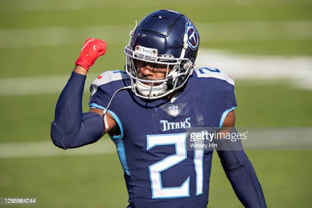 Cornerback Malcolm Butler of the Tennessee Titans signals to the sidelines during their AFC Wild Card Playoff game against the Baltimore Ravens at...