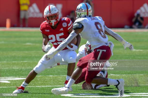 Cornerback Marcus Jones of the Troy Trojans sizes up running back Greg Bell of the Nebraska Cornhuskers in the first half at Memorial Stadium on...