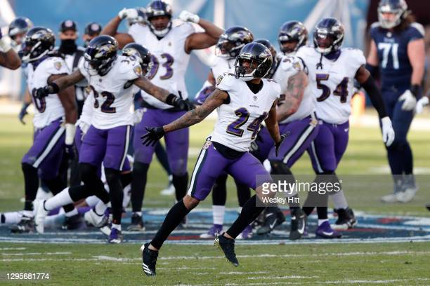 Cornerback Marcus Peters of the Baltimore Ravens celebrates following an interception during the fourth quarter of their AFC Wild Card Playoff game...