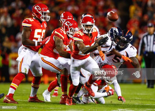 Cornerback Marcus Peters of the Kansas City Chiefs runs down fumble on his way to a touchdown against the Denver Broncos during the first quarter of...