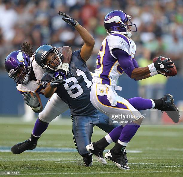 Cornerback Marcus Sherels of the Minnesota Vikings intercepts a pass against Golden Tate of the Seattle Seahawks at CenturyLink Field on August 20...