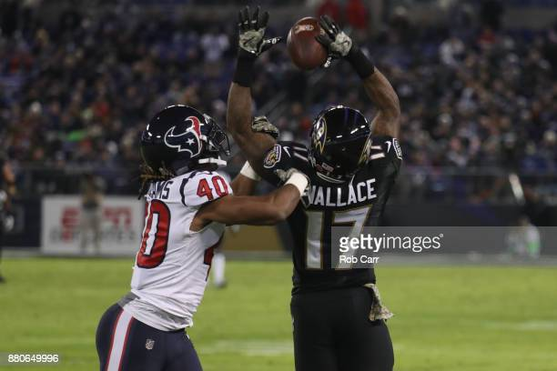 Cornerback Marcus Williams of the Houston Texans breaks up a pass to wide receiver Mike Wallace of the Baltimore Ravens in the third quarter at MT...
