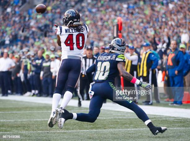 Cornerback Marcus Williams of the Houston Texans intercepts a pass meant for wide receiver Paul Richardson of the Seattle Seahawks during the fourth...