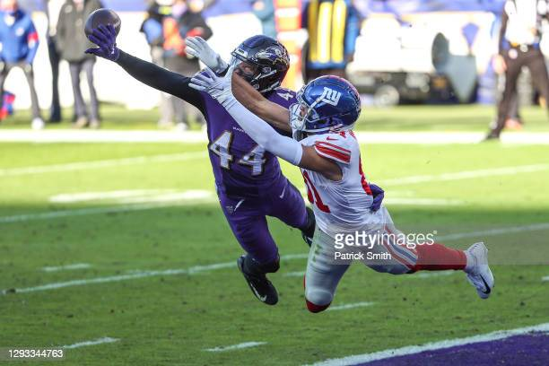 Cornerback Marlon Humphrey of the Baltimore Ravens breaks up a pass intended for wide receiver Austin Mack of the New York Giants during the second...