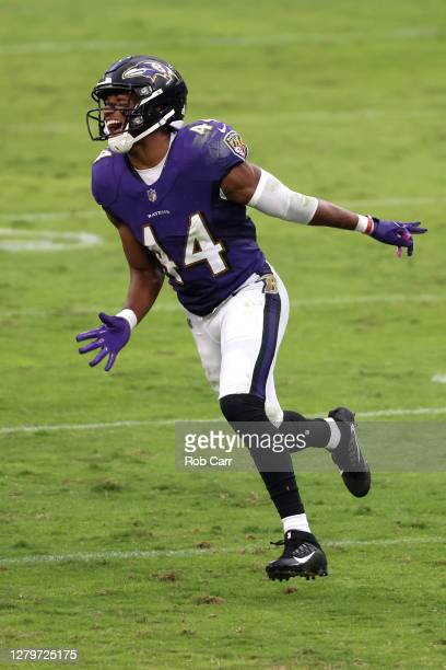 Cornerback Marlon Humphrey of the Baltimore Ravens celebrates after sacking quarterback Joe Burrow of the Cincinnati Bengals in the second half at...