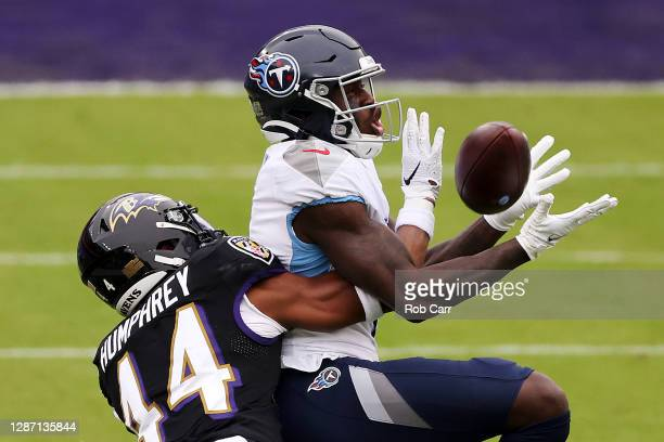 Cornerback Marlon Humphrey of the Baltimore Ravens is called for pass interference while breaking up a pass intended for wide receiver A.J. Brown of...