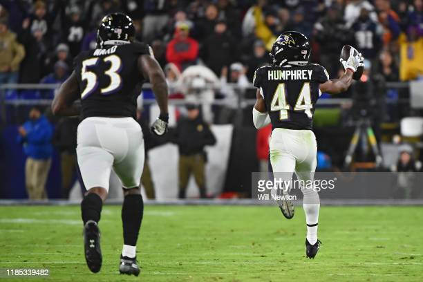 Cornerback Marlon Humphrey of the Baltimore Ravens scores a 70 yard turnover touchdown after wide receiver Julian Edelman of the New England Patriots...