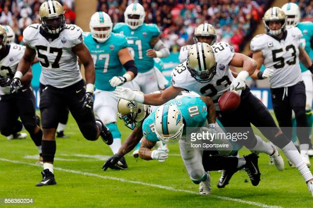 Cornerback Marshon Lattimore of New Orleans Saints forces a fumble from Wide Receiver Kenny Stills of the Miami Dolphins during the New Orleans...