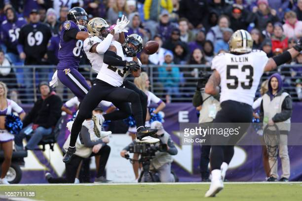 Cornerback Marshon Lattimore of the New Orleans Saints breaks up a pass to wide receiver Willie Snead of the Baltimore Ravens in the second quarter...